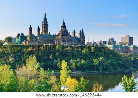 Ottawa cityscape in the day over river with historical architecture. - stock photo