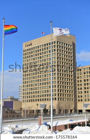OTTAWA - FEB 8:  The Gay Pride flag is flown at Ottawa City Hall, with the Dept of National Defense HQ in the background,  to show support for Gay Rights in Sochi Feb 8, 2014 in Ottawa, Canada