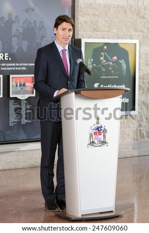 OTTAWA - JANUARY 27:  Liberal party leader Justin Trudeau speaks at a ceremony commemorating the 70th anniversary of the liberation of Auschwitz, at city hall in Ottawa on 27 January 2015. - stock photo