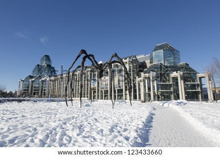 OTTAWA - JANUARY 1: The National Gallery of Canada January 1, 2013 Ottawa, Ontario, Canada. A sculpture of a giant spider, Maman by Louise Bourgeois, was installed in front of the Gallery in 2005. - stock photo