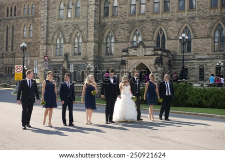OTTAWA  - JULY 5, 2014: The historic building at Parliament Hill is popular place for weddings and festive occasion. This unidentified wedding celebration was seen in the front of Parliament Building. - stock photo