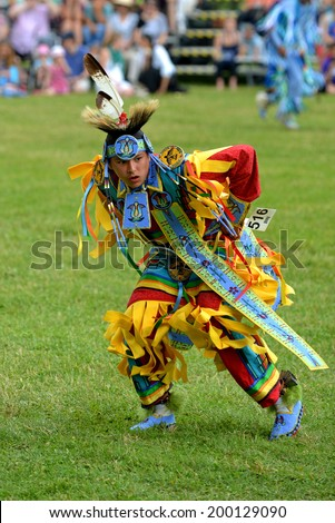 OTTAWA - JUN 21: Teenage boy performs traditional dance at Summer Solstice Aboriginal Arts Festival for Aboriginal Day in Massey Park June 21, 2014 in Ottawa, Canada - stock photo