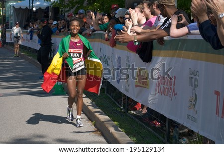 OTTAWA - MAY 25: Ethiopian runner Tigist Rufa wins women's division of the Ottawa Marathon with a time of 2:24:31, a course record, on May 25, 2014 in Ottawa.  - stock photo