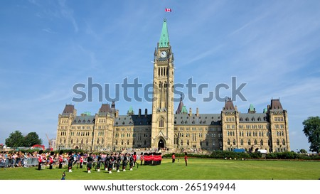 OTTAWA, ON / CANADA - JULY 2014 - The Changing of the Guard Ceremony takes place in front of the Canadian Parliament Building, Ottawa, in the morning of July 08, 2014.