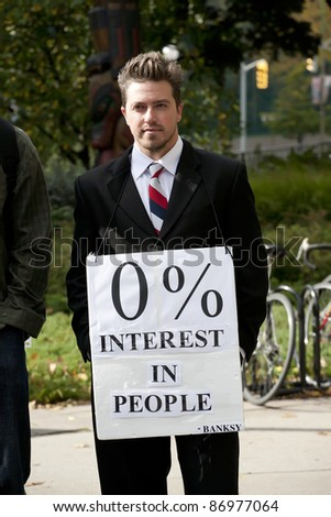 OTTAWA, ONTARIO, CANADA - OCTOBER 15: Unidentified protester holds a placard at Confederation Park where the first day of Occupy Ottawa has begun on October 15, 2011 in Ottawa, Ontario. - stock photo
