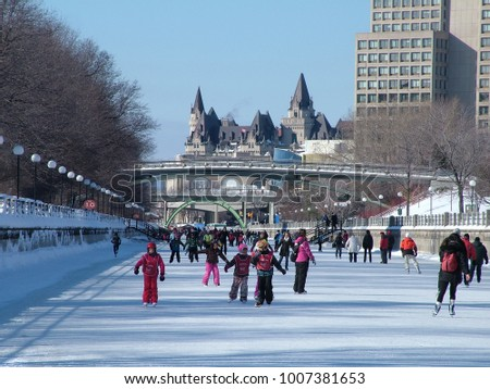 Ottawa, Ontario, Canada, 2/3/2011: Skating on the Rideau Canal during Winterlude in Ottawa, Canada.