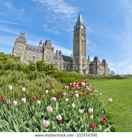 Ottawa Parliament Building and Tulips - stock photo