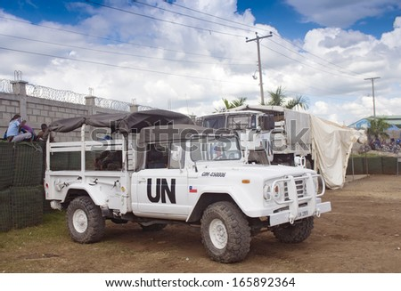 Ouanaminthe , HAITI - NOV 16, United Nations Peacekeepers Mission trucks guarding the Haitian border cross on November 16, 2013 in Ouanaminthe , Haiti