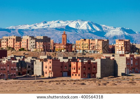 Ouarzazate city and High Atlas Mountains aerial panoramic view, Morocco. Ouarzazate is a city and capital of Ouarzazate Province in Morocco. - stock photo