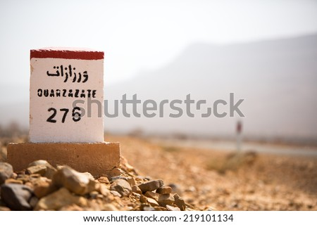 Ouarzazate 276 kilometres - road sign distance indicator on the road to Ouarzazate with blurred background, Morocco - stock photo