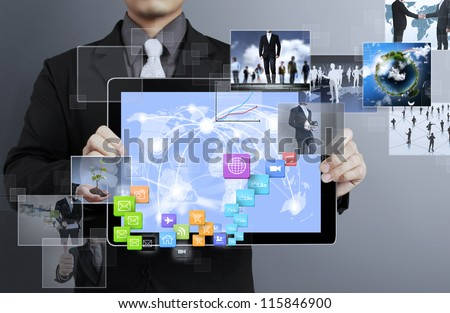 ouch screen ,touch- tablet in hand - stock photo