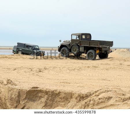 OUDDORP,NETHERLANDS 12/06/2016;This 4 x 4 beach event takes place in Ouddorp. A large beach with a track made by bulldozers and jeeps so everyone can drive there 4x4 through this sandy hill course   - stock photo