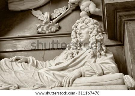 OUDENAARDE, BELGIUM-JUNY 23, 2015: Marble statue in interior of church Saint Walburga, known from 11 century - stock photo