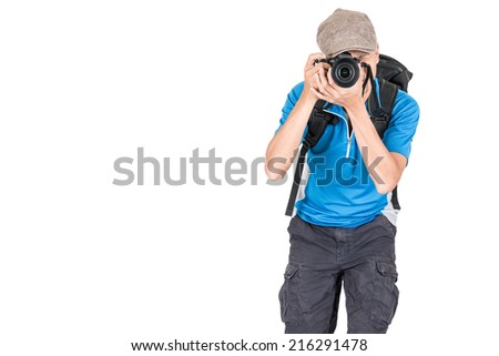oung man with backpack taking a photo