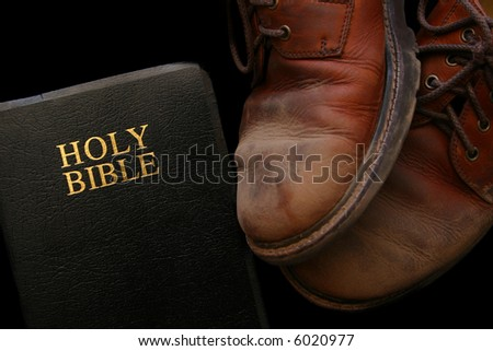 Our Christian Walk: Dusty worn-out shoes represent our persevering walk with Christ. - stock photo