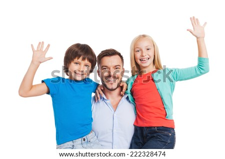 Our father is the best! Happy father carrying two cheerful children and smiling while standing against white background  - stock photo