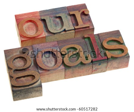 our goals concept - words in vintage wooden letterpress printing blocks, stained by color inks, isolated on white