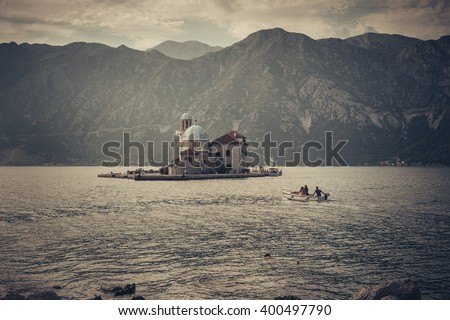 Our Lady of the Rocks (Gospa od Skrpjela) is island and church near Perast in the Bay of Kotor (Boka Kotorska) and Island of Saint George, Montenegro - stock photo