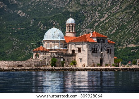 Our Lady of the Rocks, one of the two islets off the coast of Perast in Bay of Kotor, Montenegro. - stock photo