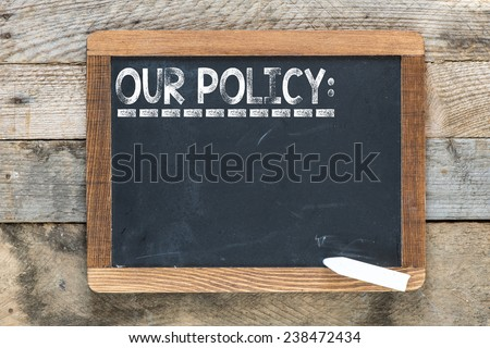 Our policy sign. Our policy sign on chalkboard - stock photo