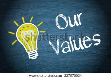 Our Values - yellow light bulb with text on blue background - stock photo