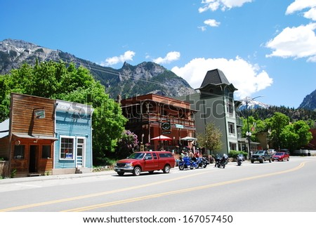 OURAY, CO, USA - JUNE 5: Main street on June 5, 2013 in Ouray, CO, USA. Ouray was a mining town in the 19th century but relies now on tourism and is called 'the Switzerland of America'.  - stock photo