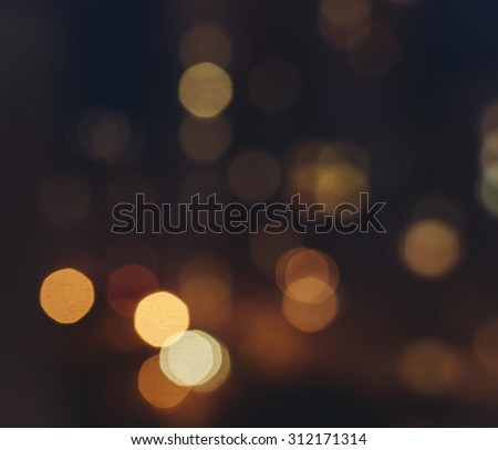 Out of focus big city lights bokeh in night time - stock photo