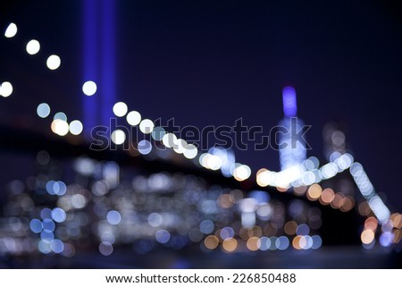 Out of focus bokeh lights of Brooklyn Bridge with the tribute in lights at September 11.  Great for backdrop or background. - stock photo