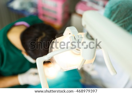 Out of focus of dentist curing a patient.A boy patient visiting dentistry office.