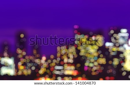 Out-of-focus shimmering night city background - stock photo