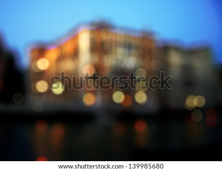 Out-of-focus shimmering urban city night background of Venice, Italy - stock photo