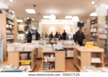 Out of focus shot from inside a bookstore, customers browsing the selections. Great as a background shot - stock photo