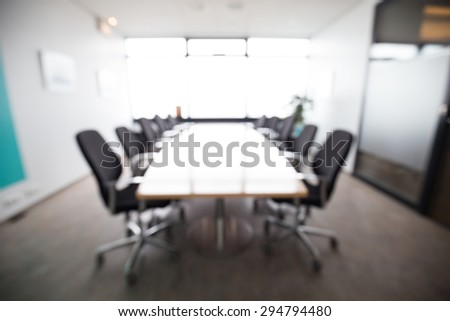 Out of focus shot of a small meeting room, could easliy be a board room  - stock photo
