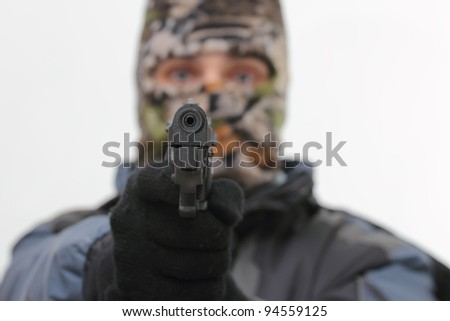 out of focus terrorist aiming a handgun