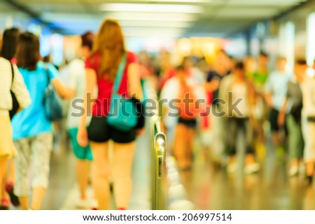 Out of focus tourist walking underground path in Hong Kong - stock photo