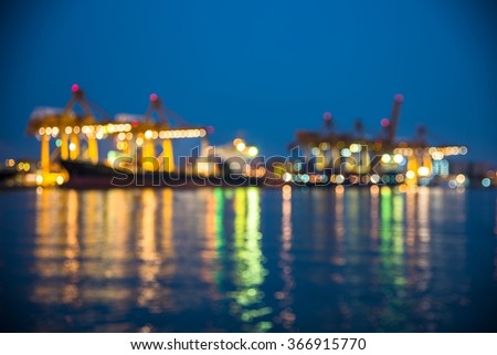 Out of focus with Ship for container working crane bridge in shipyard for Logistic  - stock photo