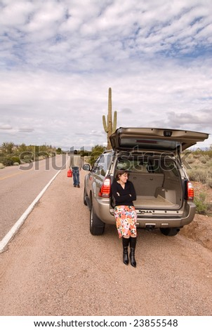 Out of gas on a desolate road during inclement weather - stock photo