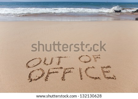Out of office. A simple concept image written in the sand on a beautiful Hawaii beach. - stock photo