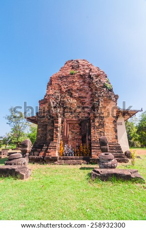 Out side of Phra That Dum, is the lone Stu-pa is built with laterite in the same period as Phra That Narai Cheng Weng, but the stupa is smaller without base.  - stock photo