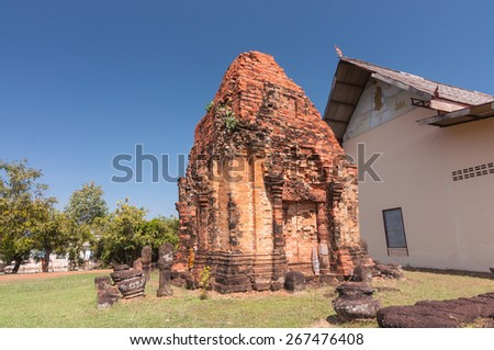 Out side of Phra That Dum, is the lone Stupa is built with laterite in the same period as Phra That Narai Cheng Weng, but the stu-pa is smaller without base.  - stock photo