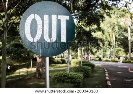 Out sign with blur tree background - stock photo