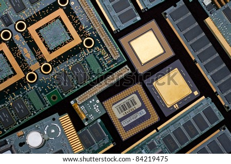 Outdated computer parts, such as ram, cpu's and nic. - stock photo