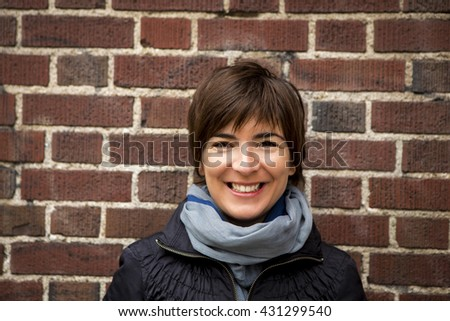 Outddor portrait of woman smiling  - stock photo