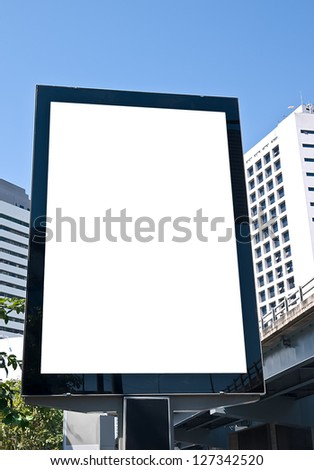 outdoor advertising board on the street in business area - stock photo