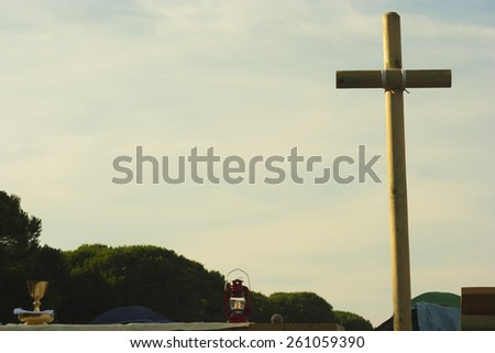 outdoor altar with wooden cross - stock photo