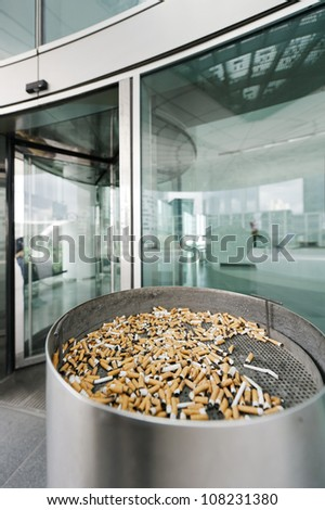 Outdoor ashtray (smoking place) for the disposal of cigarettes before entering a modern building