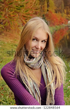 Outdoor autumn  portrait of modern  beautiful girl with scarf - stock photo