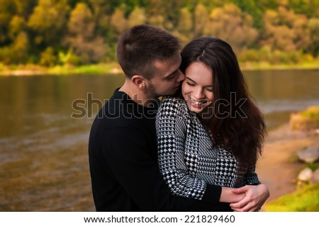 Outdoor autumn portrait of young sensual couple  - stock photo
