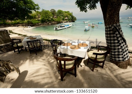 Outdoor beach restaurant at tropical resort. Lembongan, Indonesia - stock photo