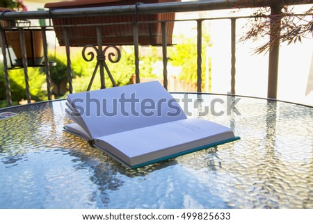 Outdoor book with defocused words, horizontal image
